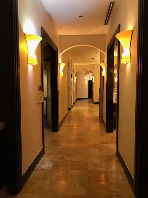 Warm tones and lighting fill the women's changing area hallway.
