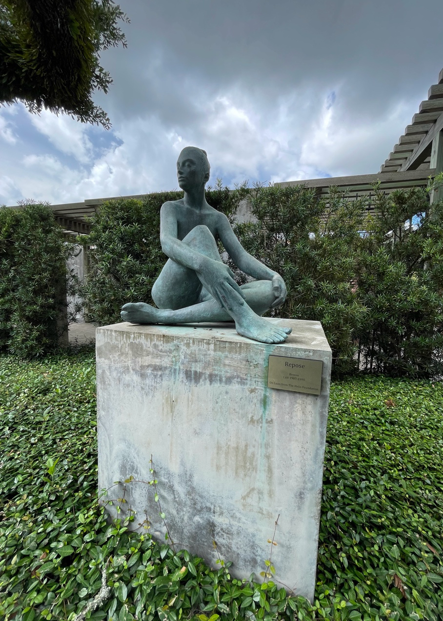 "A sculpture titled ""Repose"" sits atop a granite block in the Enrique Alférez Sculpture Garden."