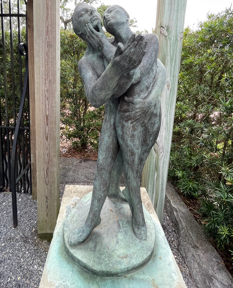 A bronze sculpture of a man and a woman embracing in dance is titled Pas de Deux.